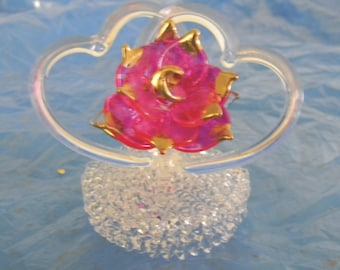 hand blown glass flower with 2 heart design