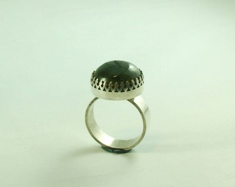 Silver ring with Labradorite in ornamental settings