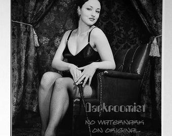 Seated pinup with crop, silver gelatin print