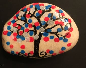 River rock red white blue dotted tree