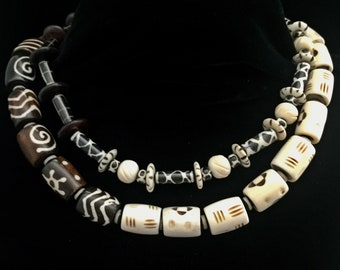 Double strand brown/bone African beaded necklace.