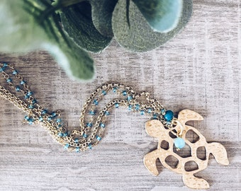 Necklace with double rosary and brass chain and turtle pendant with beads