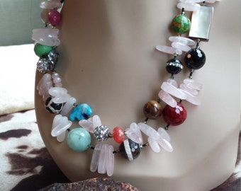 Two strand beaded faceted necklace made with assorted semi precious stones