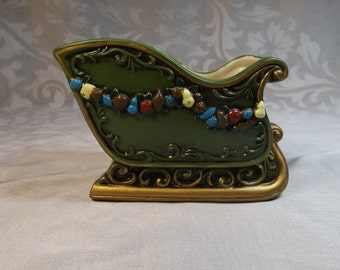 Christmas porcelain planter slide.green with gold trims and Christmas decoration.