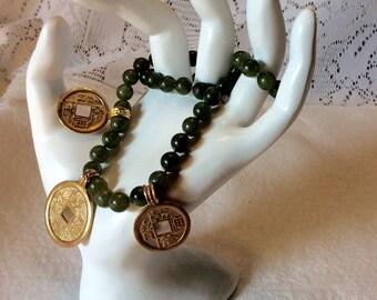 Vintage imitation jade Asian doughnut charms beaded necklace .