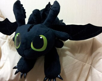 How to Train Your Dragon inspired Toothless the Night Fury (60 cm long) large plushie, made of minky plush with poseable wings.