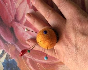 Orange felt pin cushion ring