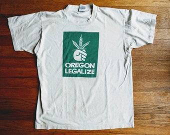 Thrashed t-shirt Marijuana Oregon Legalize 90's lottery spoof tee dingey white funky old threadbare worn Large grunge pothead hippie cool