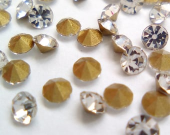 100 rhinestone faceted 2mm silver spikes