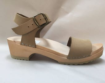 Wide strap sandal in nude nubuc with Buckled ankle strap