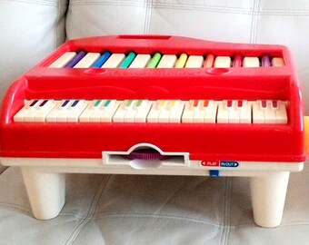 Vintage 1989 Fisher Price PLAY A SONG PIANO with 1 record # 2225 Rare and hard to find!