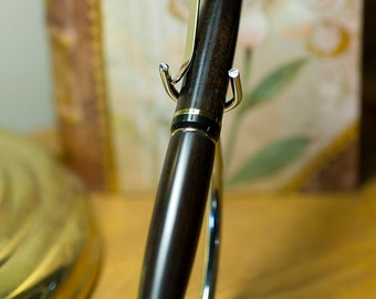 Hand crafted ball point Cigar Style pen made from African Black woo.