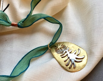 Ala Matisse Christmas Tree pendant in Brass and German Silver on Adjustable chenille ribbon