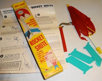 1960s Rocket Shute Toy -  cool little rocket toy. All Mint and Complete. Works
