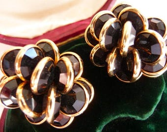 Signed Swarovski cluster clip earrings | black faceted open back crystal | bezel set gold tone mountings | vintage earrings | retired design