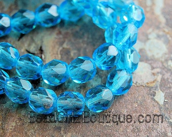 Aquamarine Blue Czech Faceted Glass Bead 4mm Round - 50 Pc