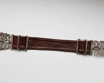 Authentic, vintage collectible silver buckle leather belt