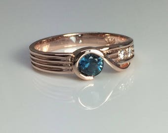 9ct Rose Gold Dress Ring with Blue Sapphire and Diamonds