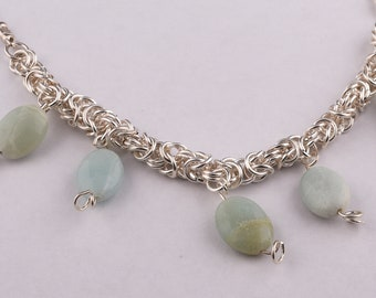 silver necklace,  braided pure silver links with mimorrpiit stones.