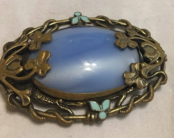 Lovely blue cabochon brooch. Early plastic stone. Brass setting. Vintage