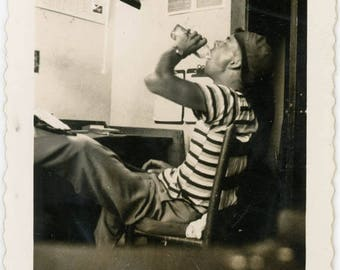vintage photo 1940s Mid Century Young Man Drinking Liquor by his Desk Snapshot