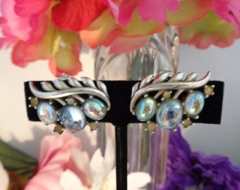 """Vintage TRIFARI Blue & Clear Winged Rhinestone Earrings in Silvertone and are over an 1"""" wide with Clip-On Backs."""