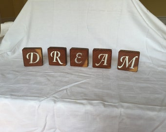 Handmade decorative blocks spelling dream