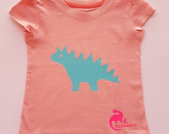 Stegosaurus t-shirt for girls - sparkly blue on pink