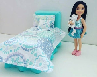 Turquoise doll bed with bedding for a 6 inch doll