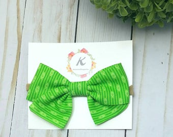 Lime green bow, hand tied bow, green tied bow, baby girl headbands, school girl bow, st Patrick day bow, nylon headband, green baby headband