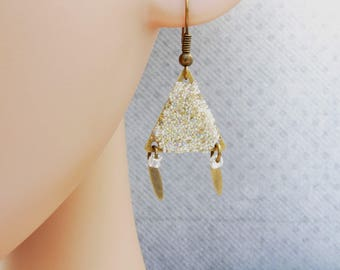 Earrings are made of sparkling