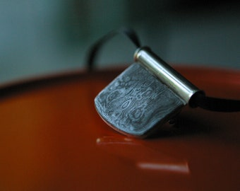 Elegant damascus pendant sterling back and bail