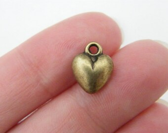 10 Heart charms antique bronze tone BC228