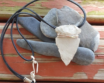 Flint arrowhead wire wrapped in sterling silver on a black leather cord