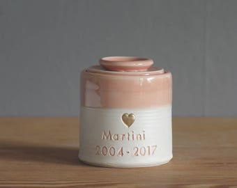 custom pet urn. gold infilled stamp with ceramic lid, straight shaped urn with heart stamp. modern simple urn for ashes. peach urn.
