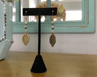 Beaded green feather leaf earrings