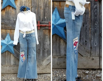"""Levis, bell bottom, patched and hand embroidered  jeans, women's size 31"""""""