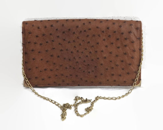 Brown ostrich leather shoulder bag or clutch with gold link handle, soft suede lining, made in Italy, circa 1980s