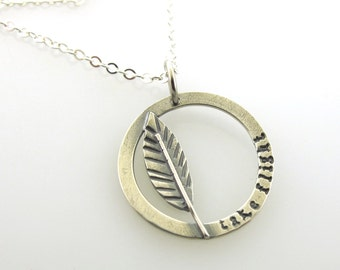 Take Flight, silver circle pendant, hand stamped charm with a feather, bird jewelry by Kathryn Riechert