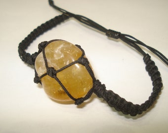 Citrine bracelet adjust to all, men and women black waxed cord,you get exactly what you see.