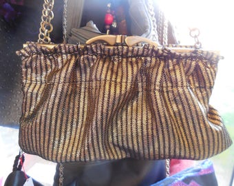 Clutch in black and gold lame with vintage style clasp