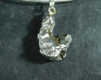 An Authentic Meteorite Made into a Pendant or Necklace a Falling Star! 7.58