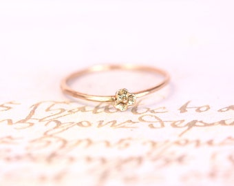 14kt. yellow gold sweet tiny little flower ring