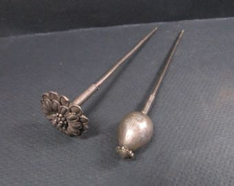 Two African hair pins