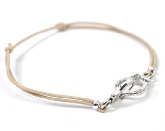 Silver cuff bracelet beige cord
