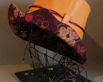 Orange yellow leatherette rain hat, wave shaped fancy edge.