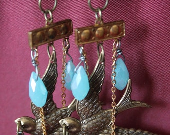 The Birds of Heaven assemblage Chandelier Earrings , Sterling Silver old Religious medals, Brass Swallow Stamping, Glass beads,Art Deco