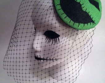 Green and black Boogie man fascinator hat. Portion of sale goes to charity.