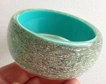 Bangle - A funky chunky  turquoise blue plastic bangle  with silver inclusions retro design