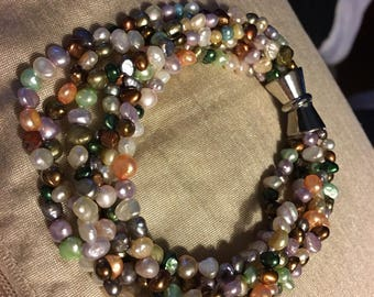 Multi colored and size seed pearls 6 strands 18 carat gold plated magnetic clasp
